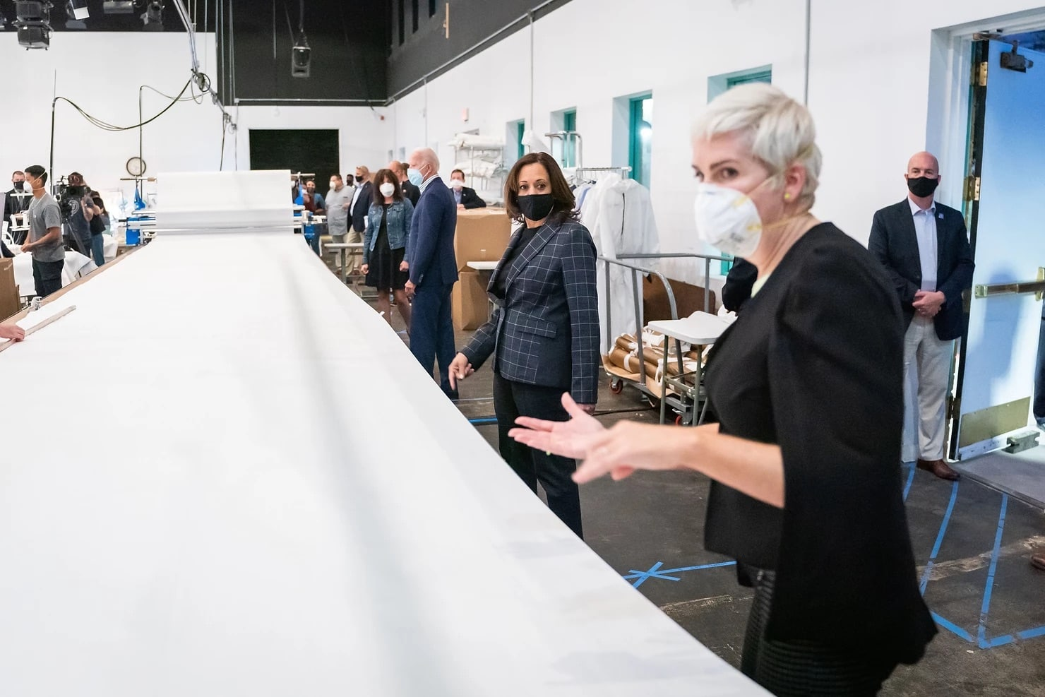 Kamala Harris being shown PPE manufacturing