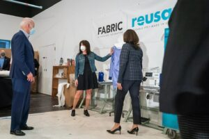 Showing Vice President Biden a Reusa Isolation Gown