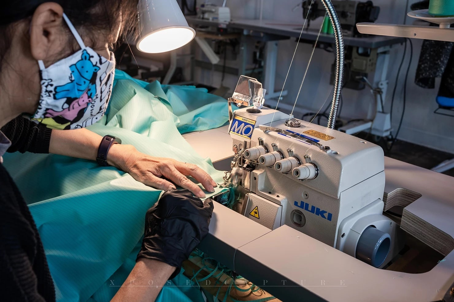 Woman Sewing PPE Gowns